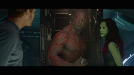 Dave Bautista as Drax and Zoe Saldana as Gamora